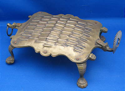 Metalware<br>Archives<br>Anthropomorphic Brass Grater