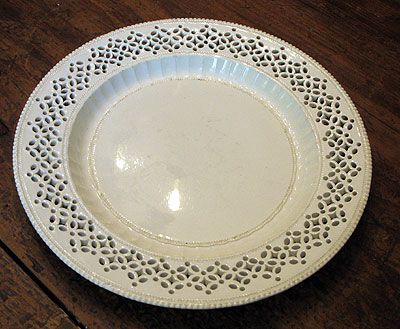 SOLD  A Large Creamware Pireced Plate