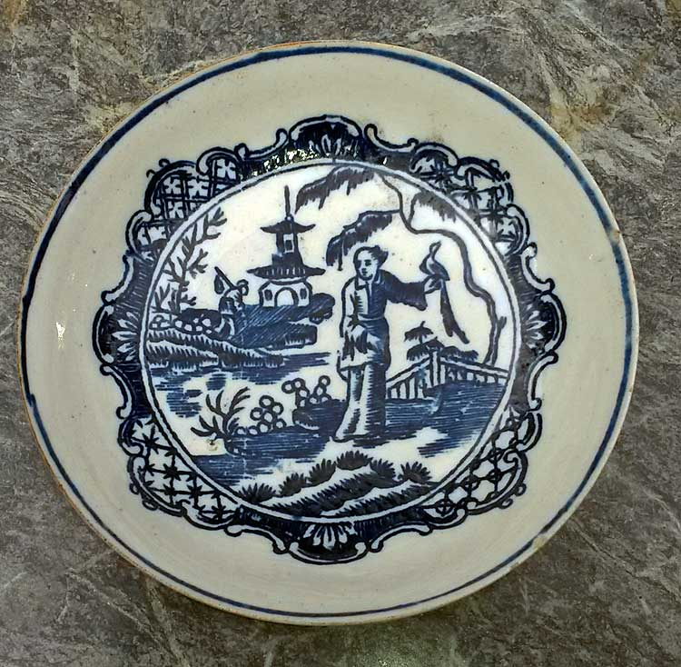 Early porcelain saucer with Chinoiserie transfer print.