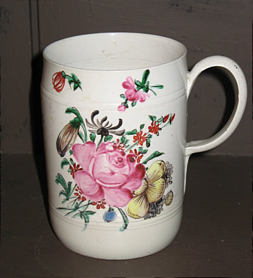 SOLD   SALTGLAZE MUG WITH FLORAL ENAMEL DECORATION