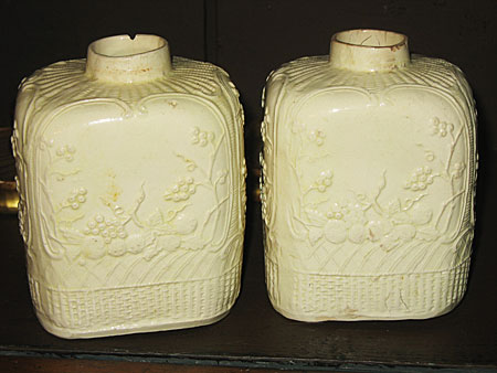 SOLD  A pair of creamware tea canisters