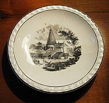 Porcelain Saucer with bottle oven transfer