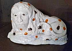 Creamware lion with spots
